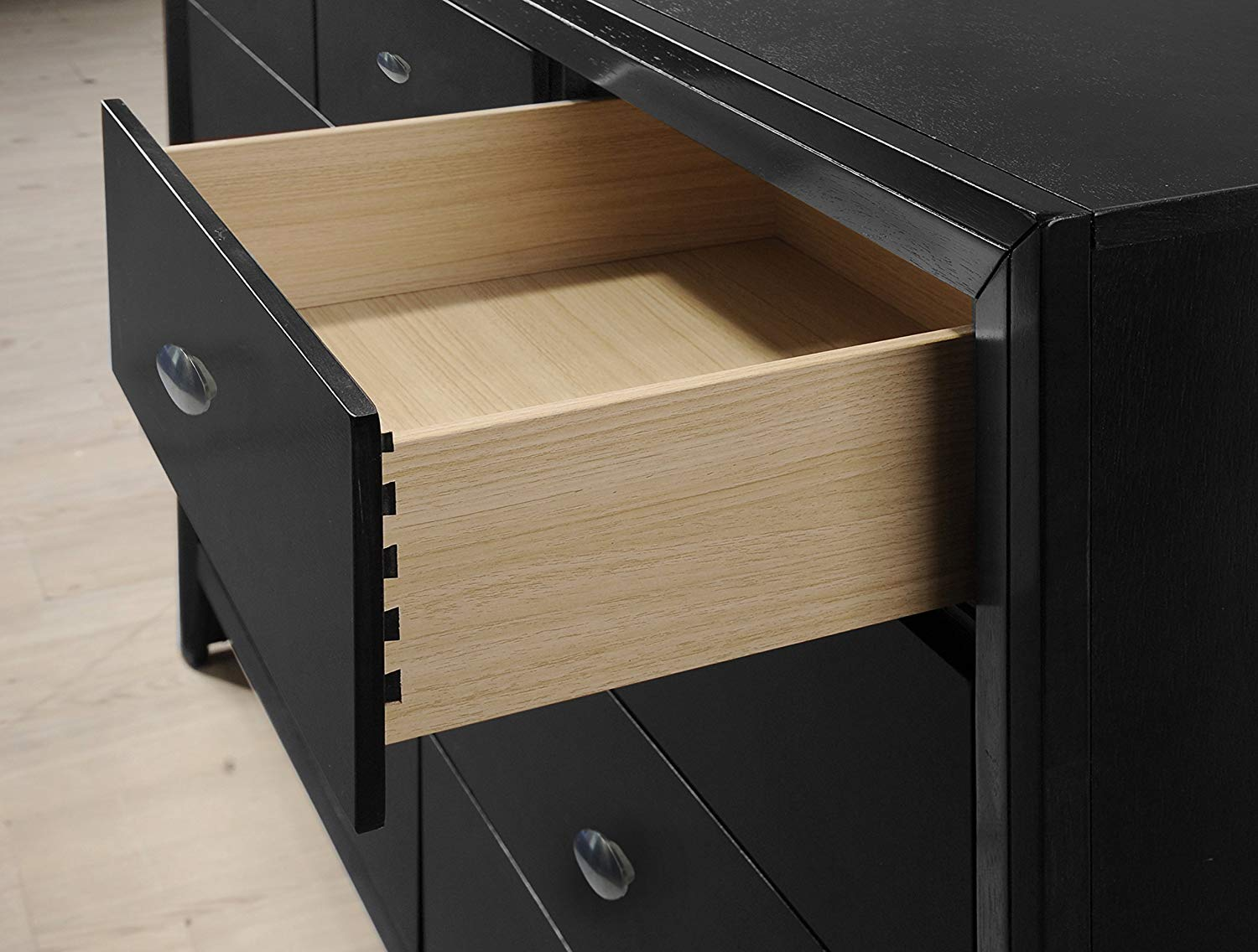 Full-extension, smooth drawer glides ensure easy opening and closing.